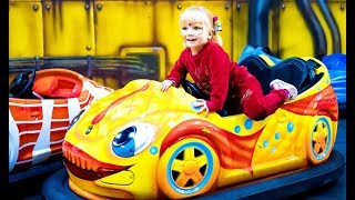 Family fun at the play area with attractions for children ! Super Vanessa racing on kids cars