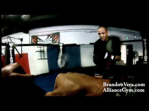UFC Fighter Brandon Vera Holding Mitts For UFC Fighter Ross Pearson At Alliance Training Center Image 1