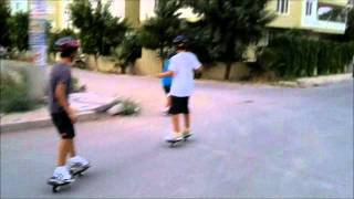 young two wheeled skate board riders