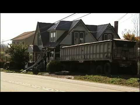 Coal truck crashes into house