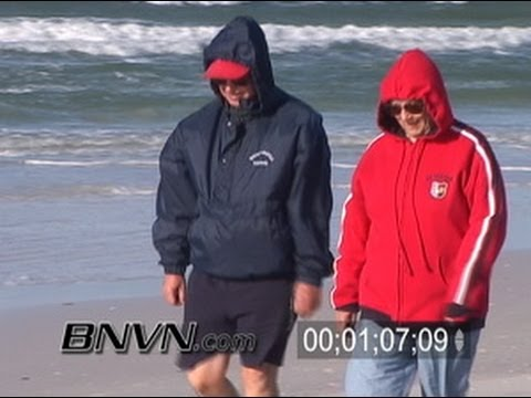 1/6/2006 Siesta Beach FL Cold Surfers Cold windy morning at the beach footage