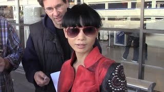 Bai Ling Takes Photos With The Paparazzi At LAX