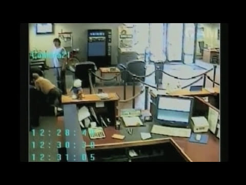 Fearless customer tackles bank robber