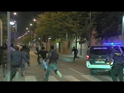 African migrants storm Spanish border fence