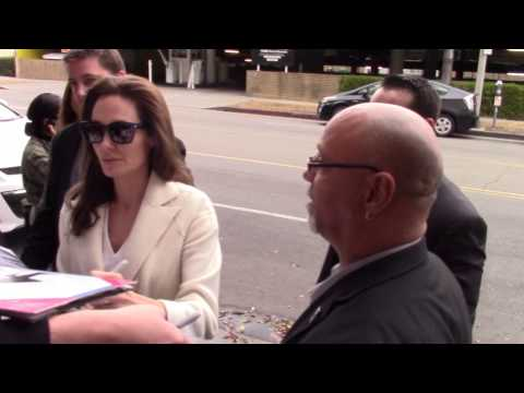 Sexy Angelina Jolie jokes with fans while signing autographs