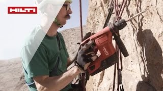 Setting rock climbing routes is a challenging job - reach for the Hilti