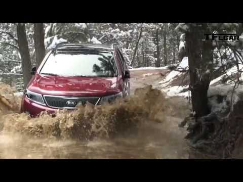 The new 2014  KIA Sorento playing in the Mud