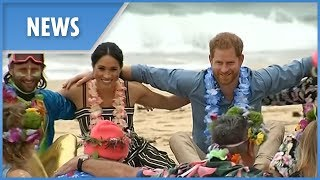 Prince Harry climbs Sydney Harbour Bridge to raise Invictus Flag - Meghan Markle visits Bondi Beach