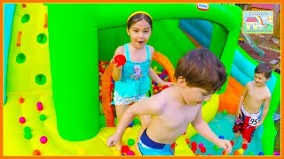 Kids Playing on Giant Inflatable Water Slides! Outdoor Playground
