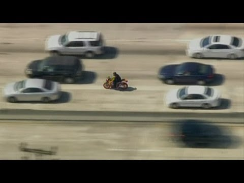 Police chase in Los Angeles: Biker reaches 106mph as he weaves through traffic inches from vehicles