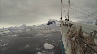 Navigation in Antarctica between Sea Ices and Icebergs