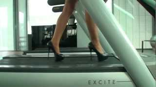 TAMIA ON A CROSSTRAINER IN DESIGNER HIGH HEELS & PANTYHOSE