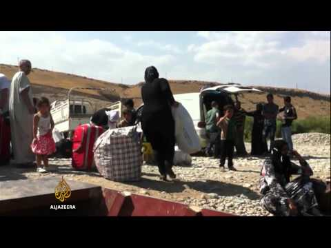 Syrian refugees in Iraq face risks to go home