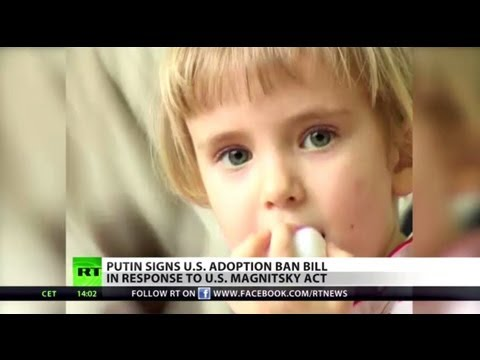 Putin signs law banning American adoption in Russia
