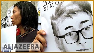 Hong Kong: Missing British consulate worker's supporters protest
