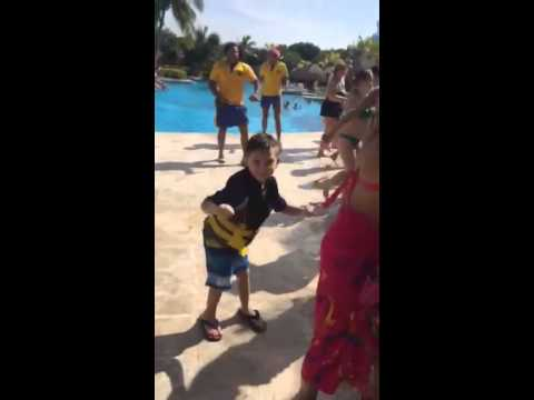 little boy dancing with girls in bikinis