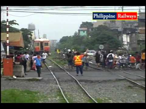 Philippine Railways: PNR Kiha 52 (キハ52), passing General Santos Railroad XING
