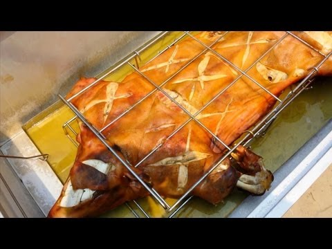 How to Roast a Pig in La Caja China (Warning: Not suitable for all to watch)