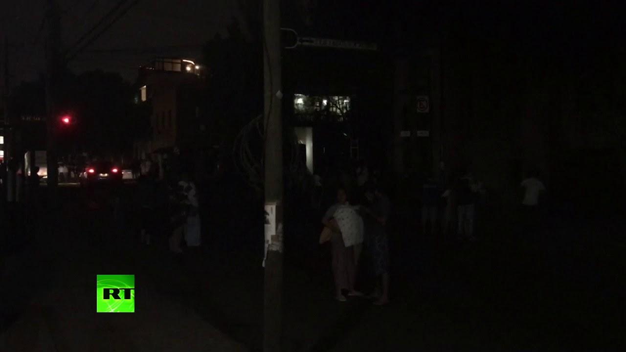 People evacuated on street as 8.0 quake strikes off southwestern Mexico coast