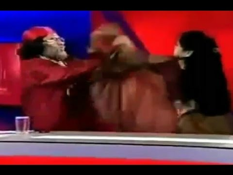 Woman slaps Om Ji Maharaj on Live TV show in India | Radhe Maa | IBN7 | Live fight funny