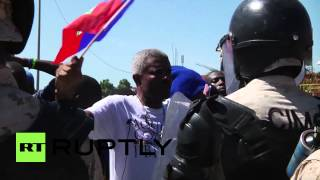 Police used Tear Gas on Pro Jean Bertrand Aristide Supporters