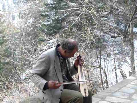 Turkish musician playing kemence in Sumela monastery, Trabzon, Turkey.