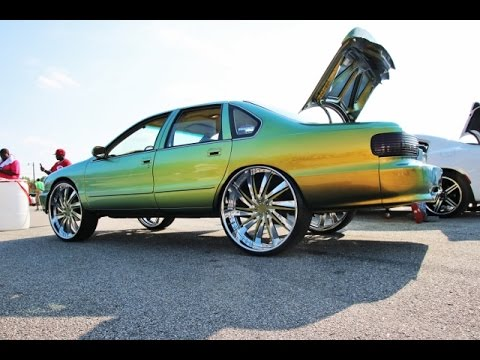 WhipAddict: 96' Chevrolet Impala SS on DUB 28s. Kandy Flip Flop Paint. Custom Interior