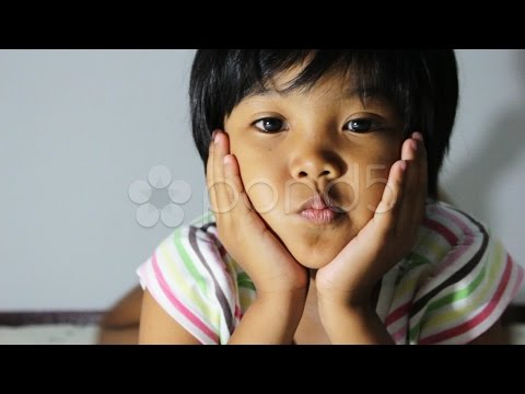 Asian children on the bed. Stock Footage
