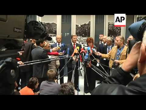 Russia''s Libyan embassy raises rebel flag, French and German FMs comment