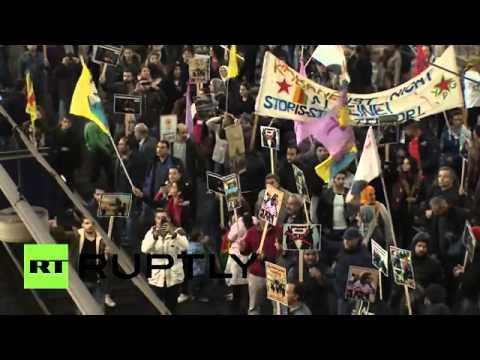 Kurdish protesters break through police lines, storm train tracks in Hamburg