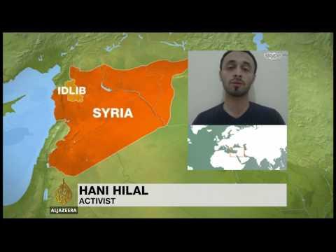 Dozens killed in Syria barrel bomb 'massacre'
