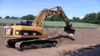 Cat 325D Excavator Grading