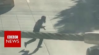 Footage shows New York suspect tackled by police - BBC News