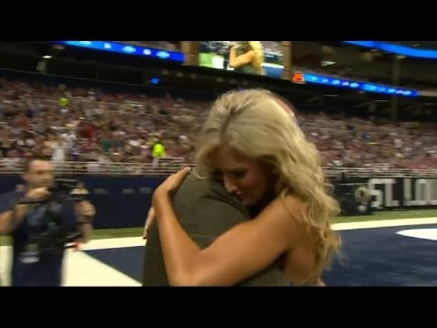 NFL Cheerleader Gets Surprise Homecoming from Marine Husband