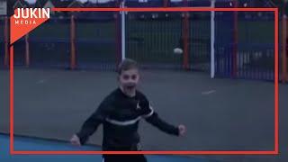 Kid Kicks Rugby Ball Straight Into Basketball Hoop