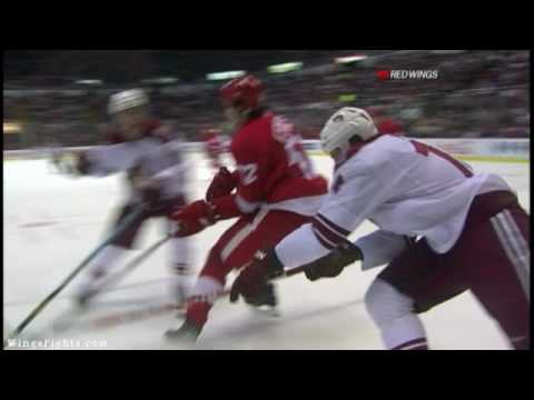 Jonathan Ericsson Knee on Knee with Shane Doan