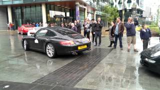 Supercars at MediaCityUK setting off for Chomondely Supercar Rally - pageant of power