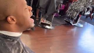 Kelontae Gavin sings at the BarberShop