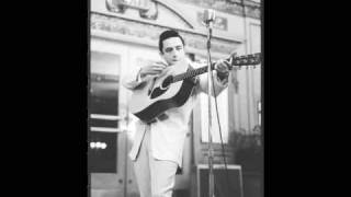 Watch Johnny Cash The Man Comes Around video