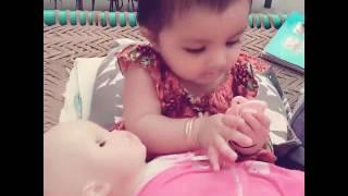 Ayeza with doll.