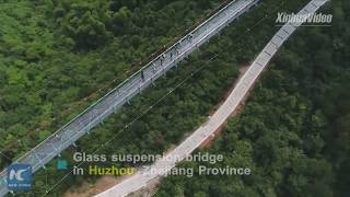 Thrilling! New glass suspension bridge opens in E China