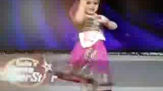 Sweet little girl dancing on stage