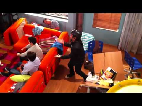 Big Time Rush on set: Carlos Pena breaks a table