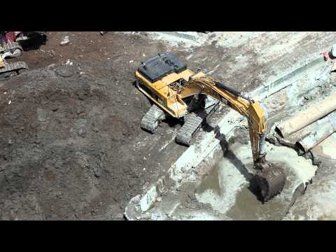 Cat 345DL Excavator digging underwater