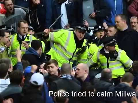 Young girl cries as fighting breaks out, Millwall Vs Wigan, FA CUP soccer match