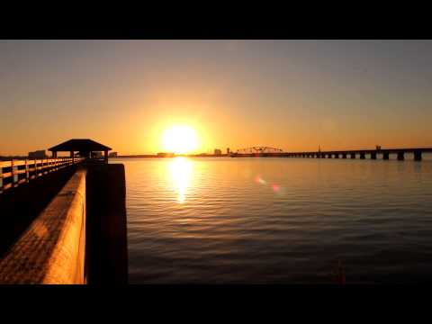 Sunset Ocean View Fishing Pier and Train Track Biloxi Skyline View (Stock Footage) AMASF