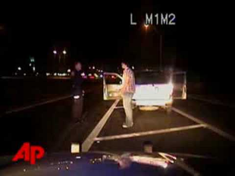Raw Video: Dog Dies While Cop Detains Owners