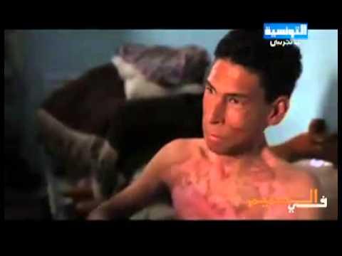 image vid�o فظيييع جدااا!! ربطه رجل أمن إلى عمود وأضرم فيه النار