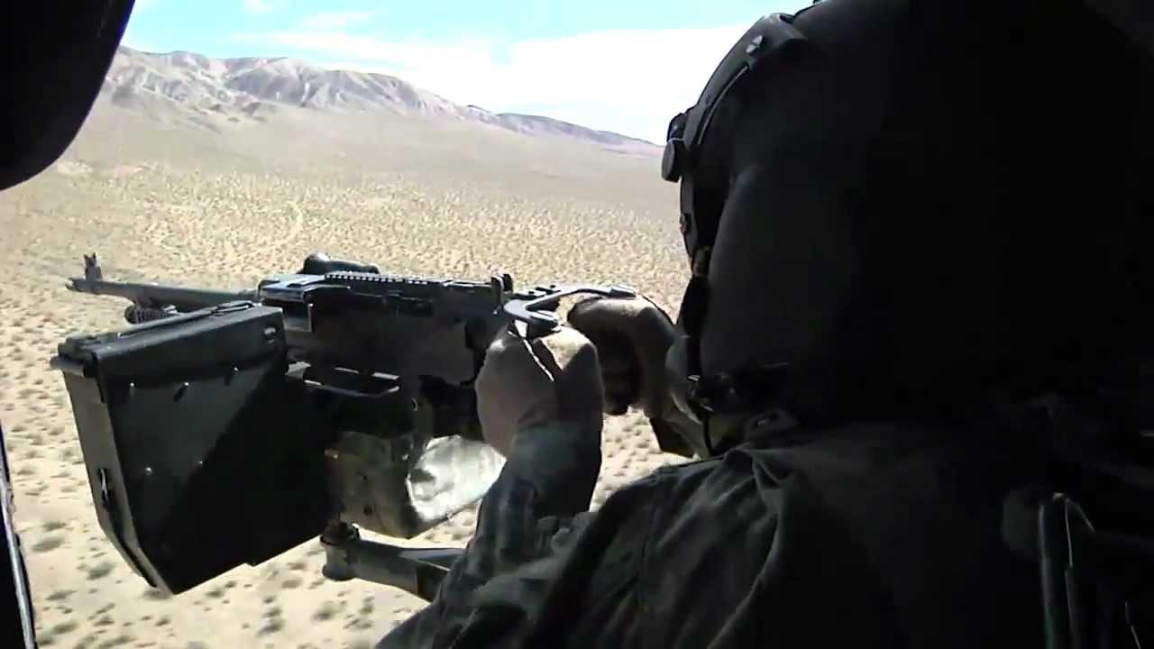 door gunner m240h machine gun on a uh60 helicopter