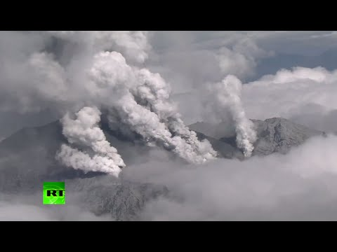 Aerial Japan volcano footage: Mt Ontake spews giant ash cloud, locals flee